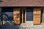 European oak narrow french doors with ledged and braced stable doors infront copper capping to lower stable door